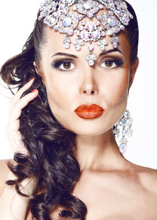 Glamour. Beautiful Woman with Jewelry - Shiny Diadem photo