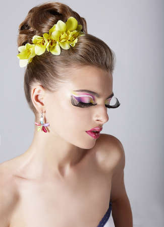 garish: Womans Face with Bright Trendy Eye Makeup.  Long False Eyelashes Stock Photo