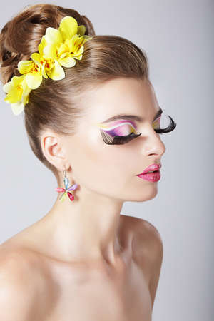 Glam. Profile of Fashionable Woman with Amazing Fantastic Eye Make-up photo