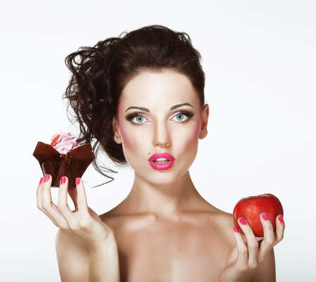 indulging: Dilemma  Diet  Undecided Woman with Apple and Cupcake