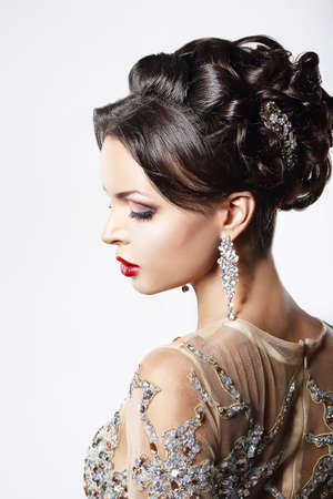 platinum hair: Profile of Classy Brown Hair Lady with Jewelry and Festive Hairstyle