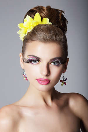 showy: Eccentric Showy Woman with Vivid Colorful Makeup and False Long Eyelashes