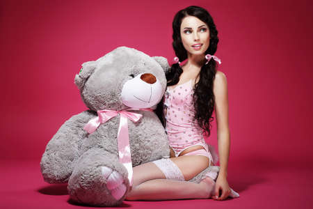 Sentiment  Valentine  Young Woman with Soft Toy Sitting  Sensuality