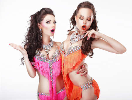 Clubbing  Two Women Showgirls in Stage Dresses photo