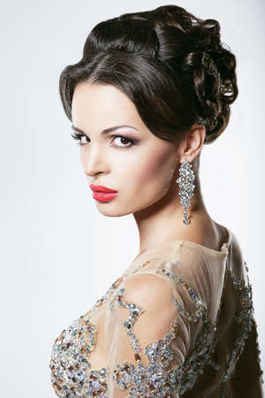 showy: Prosperity  Luxury  Glamorous Showy Woman with Diamond Earrings