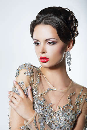 Elegance. Luxurious Good Looking Woman in Dress with Sequins and Jewels photo