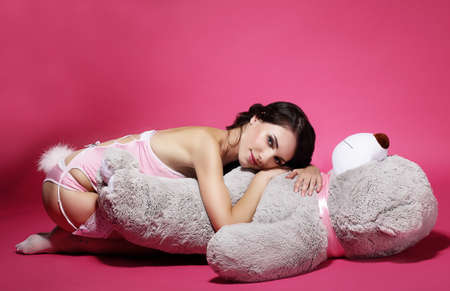 Tenderness. Sentiment. Daydreaming Woman with Teddy Bear Laying photo