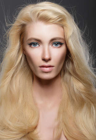 light complexion: Pure Beauty. Portrait of Young Blonde with Healthy Flowing Hair