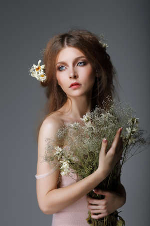 Sentimentality. Redhaired Affectionate Muse with Flowers in Dreams Stock Photo - 23263703