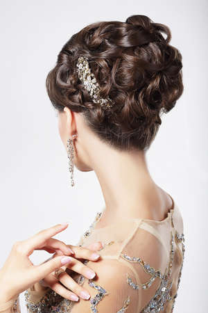 earring: Refinement and Sophistication. Stylish Woman with Festive Coiffure Stock Photo