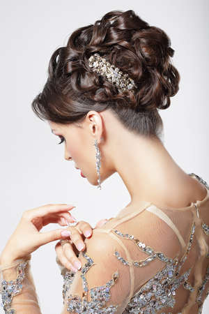 prom: Elegance and Chic. Beautiful Brunette with Classy Hairstyle. Luxury Stock Photo
