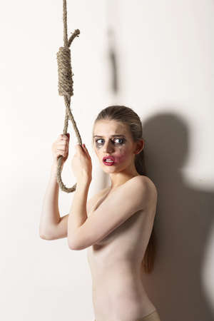 hang body: Violence. Unhappy Bizarre Woman Hipster Self-Murder with Noose of Rope Stock Photo