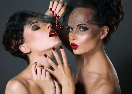 Dainty  Two Provocative Women in Veils with Cherry Berries  Temptation photo