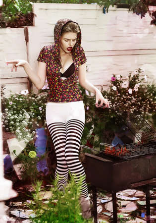 Joke. Eccentric Crazy and Funny Woman Hipster cooks Barbecue on Bbq Grill photo