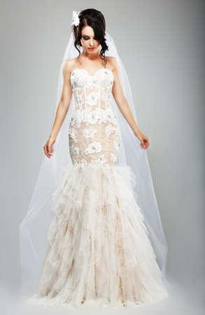 bridal salon: Wedding Style. Elegant Bride in White Long Bridal Dress Stock Photo