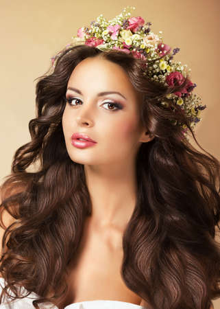 Classy Fashion Model with Perfect Flossy Brown Hair and Wreath of Flowers photo