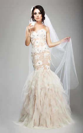 bridal veil: Fashionable Woman in White Dress holding Wineglass of Champagne