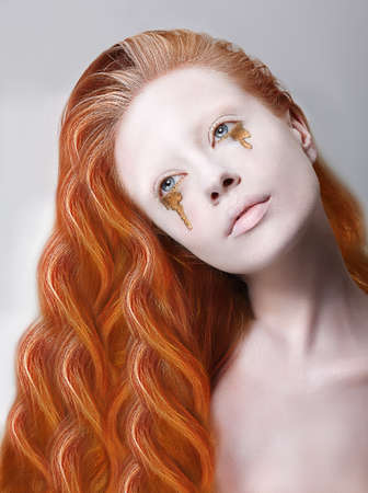 stagy: Harlequin. Artistic Red Hair Woman with Painted Face and Creative Makeup