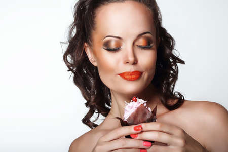 foretaste: Gourmet. Woman Holding Unhealthy Food - Appetizing Chocolate Muffin