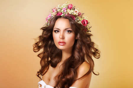 Elegance. Classy Adorable Lady with Flowers and Flowing Hair photo