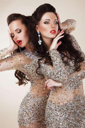 Radiance. Glam. Luxuus Rich Women In Grey Dresses with Rhinestones Stock Photo - 24949989