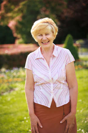 Elegance. Elation. Happy Senior Woman Outside with Toothy Smile Stock Photo