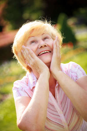 elation: Elation. Ecstasy. Surprised Glad Grey-Haired Senior Woman Looking Up