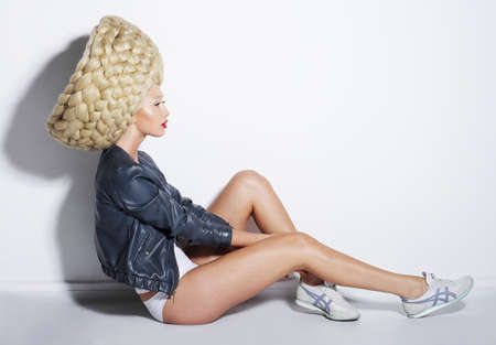 futurism: High Fashion. Futurism. Extraordinary Woman in Artificial Twisted Wig Stock Photo