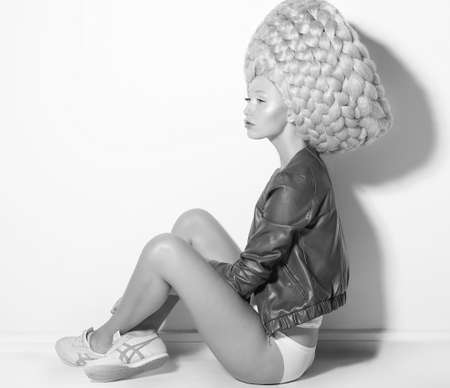 periwig: Vogue. Fanciful Eccentric Woman Fashion Model in Creative Periwig sitting