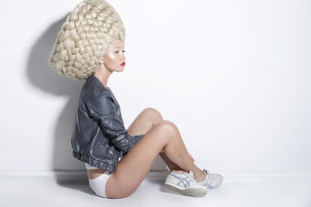 upsweep: Fantasy & Inspiration. Woman in Unusual Wig with False Braided Hair Stock Photo