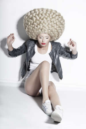 periwig: Extravagance  Eccentric Blonde Hair Model with Fantastic Updo Coiffure Stock Photo