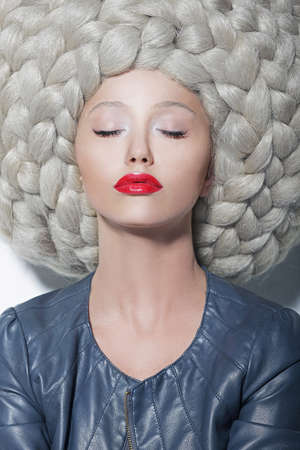 Fantasy  Creativity  Portrait of Trendy Woman in Futuristic Sumptuous Huge Wig with Braids photo