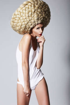 periwig: Ultramodern Hairstyle  Trendy Woman with Creative Art Wig with Braids Stock Photo
