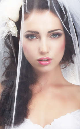 upscale: Delicacy  Caucasian Woman Hidden behind Traditional Bridal Veil
