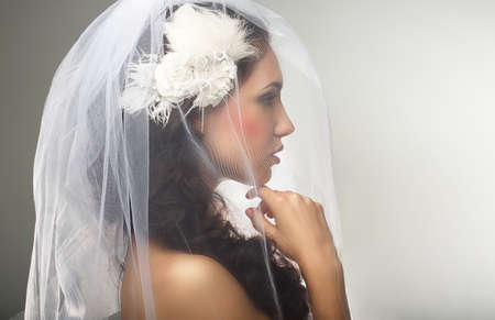 sincere: Engagement  Loveliness  Side view of Sincere Affectionate Woman in Veil