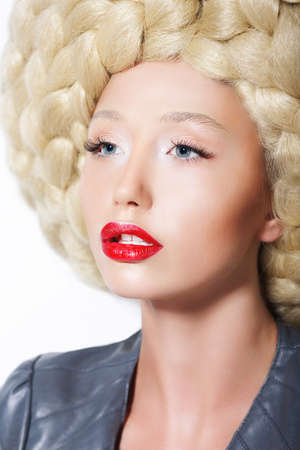 platinum hair: Extravagant Hairstyle. Stylish Woman with Creative Art Trendy Wig