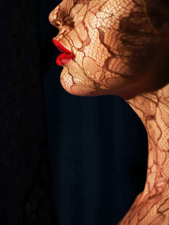 painted image: Profile of Futuristic Woman s Face with Openwork Lace in Shadows