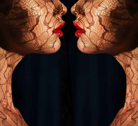 Fantasy  Two Women s Faces with Tracery Opposite each other  Reflexion photo