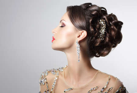 updo: Fashionable Brunette with Costume Jewelry - Trendy Rhinestones and Strass