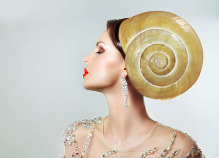 peculiar: Extravagancy. Outlandish Extreme Hairstyle. Peculiar Woman with Snail as Headwear