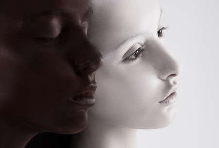 cultural diversity: Cultural Diversity  Two Faces Colored Black   White  Yin Yang Style Stock Photo