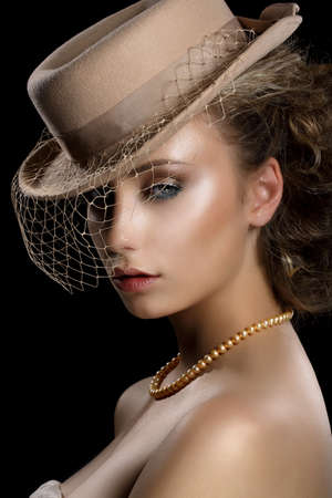 pearly: Charm  Retro Styled Romantic Woman in Vintage Brown Hat and Veil  Nostalgia
