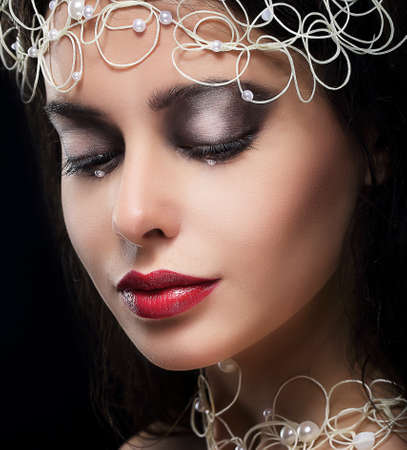 reverie: Stylish Fashionable Young Woman with Pearls in Reverie