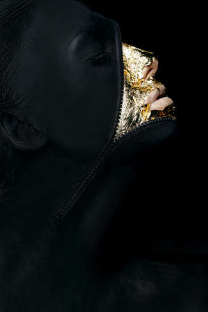 Creative Concept  Surreal Fancy Woman Painted Black with Zip Fastener on her Outlandish Face Stock Photo