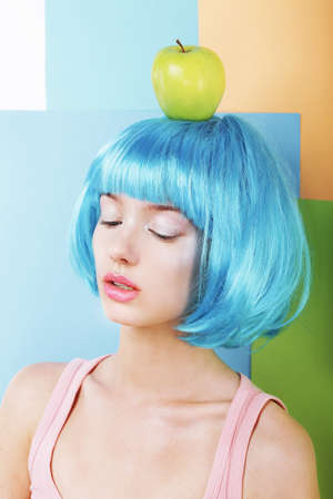 periwig: Bizarre Stylized Woman in Blue Wig with Green Apple