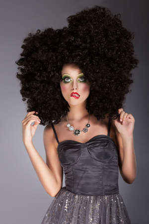 frizzy: Extravagance. Eccentric Emotional Woman in Frizzy Fancy Wig with Braided Hairs