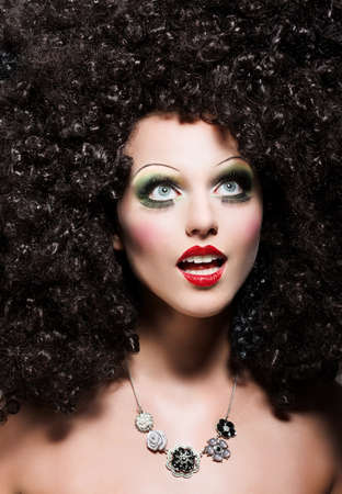 stagy: Creativity. Theatrical Emotions. Woman with Fantastic Coiffure looks like Doll Stock Photo