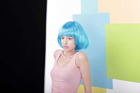 periwig: Portrait of Pensive Beautiful Girl in Fancy Blue Wig and Pink Singlet