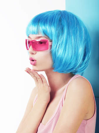 periwig: Manga Style. Profile of Charismatic Woman in Blue Wig Blowing a Kiss