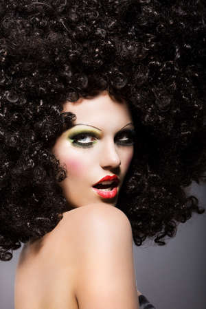 periwig: Haute Couture. Charisma. Trendy Woman with Creative Hairstyle Staring